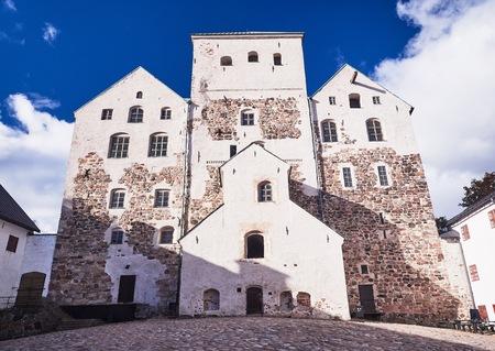 Turku castle in bright sunshine in Finland on a sunny summer day.