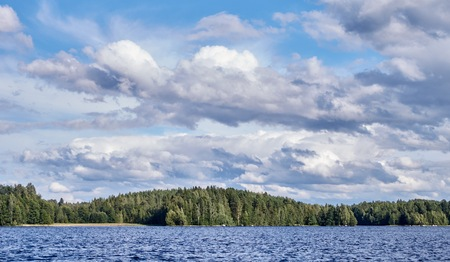 Dramatic cumulus clouds in the bright summer day scene in Finland.