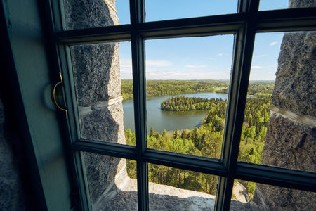 Landscape view  through a window at Aulanko lookout tower  in Finland.