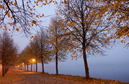 Autumn colors and misty lake in Hameenlinna, Finland.
