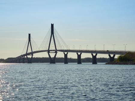 Replot (Raippaluoto) Bridge in Vaasa, Finland. Clear summer evening sky and no trafic on the road.