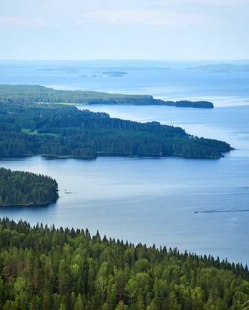 Scenic summer landscape view over the lake Pielinen from the top of the UkkoKoli, a fell at the Koli national park in Joensuu, Finland, the land of a thousand lakes. Stok Fotoğraf