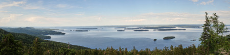 Summer panorama view over the lake Pielinen from the top of the UkkoKoli, a fell at the national park Koli, Joensuu, Finland, the land of a thousand lakes.