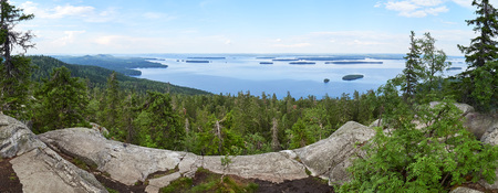 Summer panorama view over the lake Pielinen from the top of the Ukko-Koli, a fell at the Koli national park in Joensuu, Finland, the land of a thousand lakes. Stok Fotoğraf