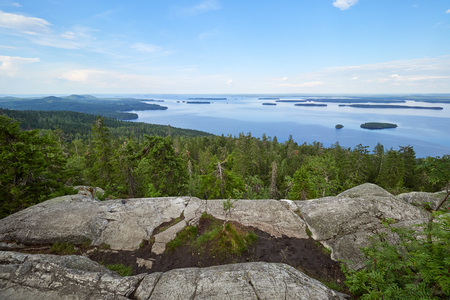 Summer landscape view over the lake Pielinen from the top of the UkkoKoli, a fell at the national park Koli, Joensuu, Finland, the land of a thousand lakes. Stok Fotoğraf