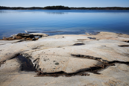 Peaceful summer landscape by the Baltic Sea in Kasnäs, Kemiö, Finland. Wide angle shot of the rocks on the seashore at Finnish archipelago.