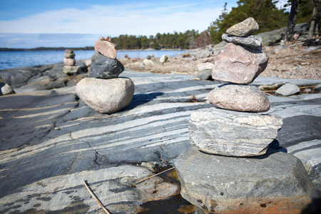 Peaceful summer landscape by the Baltic Sea in Kasnäs, Kemiö, Finland. Wide angle shot of the stack of rocks on the seashore in the Finnish archipelago.
