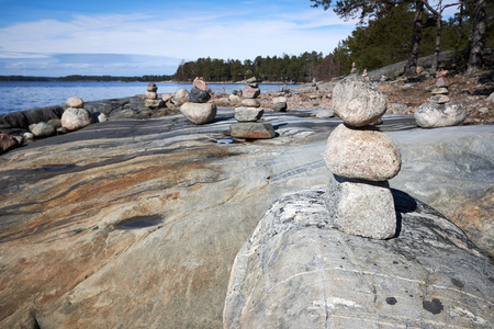 Peaceful summer landscape by the Baltic Sea in Kasnäs, Kemiö, Finland. Wide angle shot of the rocks on the seashore in the Finnish archipelago. Stok Fotoğraf