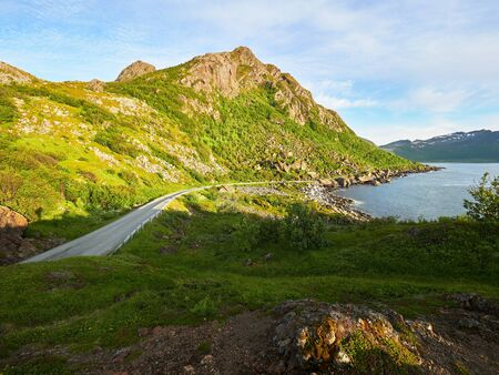 Small mountain road at the famous tourist attraction Hamn Village, Senja island, Troms county - Norway Banco de Imagens