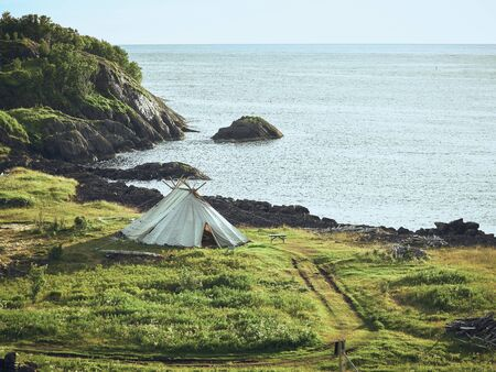 Old teepee tent at the famous tourist attraction Hamn Village, Senja island, Troms county - Norway Stock Photo