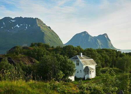 White house at the famous tourist attraction Hamn Village, Senja island, Troms county - Norway