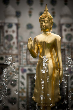 body dimensions: Golden Buddha statue in a temple, thailand