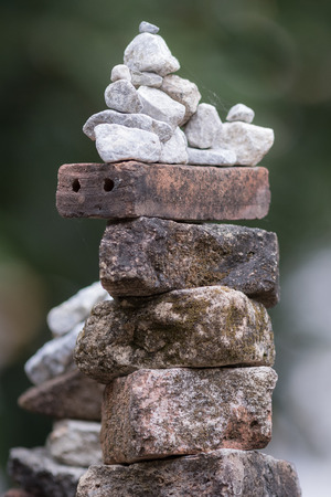 Balance of stones on blur background.