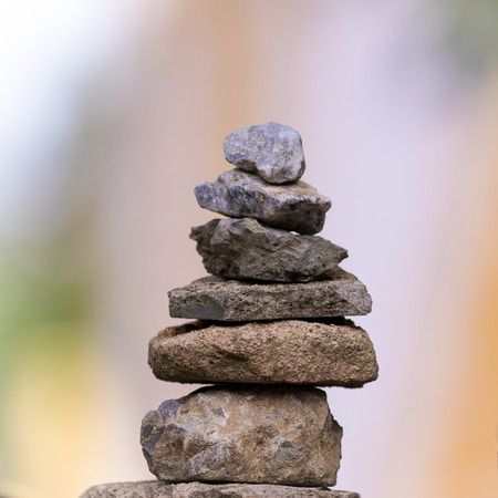Balance of stones on blur background.