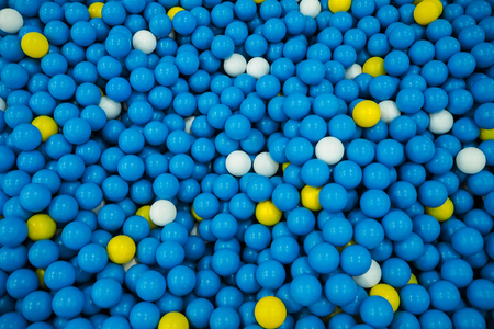 Background of colorful plastic balls for kids to play on the playground Stock Photo