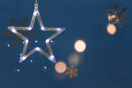 White electric light star with blue background.