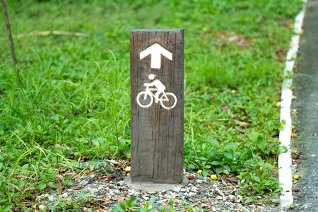 central park: Bike Sign On the wood Stock Photo