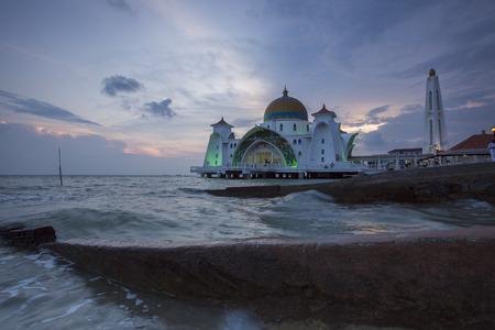 islamic scenery: Malacca Straits Mosque in sunset - Masjid Selat Melaka. It is a mosque located on the man-made Malacca Island near Malacca Town. Malaysia Editorial