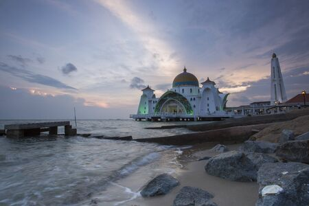 Malacca Straits Mosque in sunset - Masjid Selat Melaka. It is a mosque located on the man-made Malacca Island near Malacca Town. Malaysia Editorial