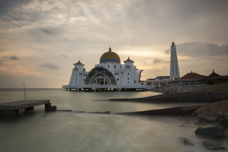 istanbul beach: Malacca Straits Mosque in sunset - Masjid Selat Melaka. It is a mosque located on the man-made Malacca Island near Malacca Town. Malaysia Editorial