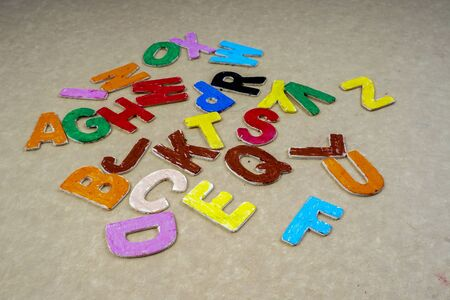 christmas cookie: Alphabets isolated on wooden board.