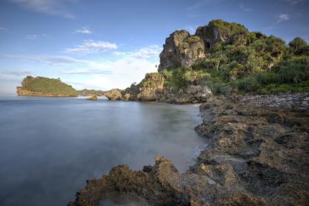Amazing view of Yogyakarta seascape with natural coastal rock as foreground