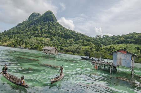 animal trap: Sabah, Malaysia-July 10, 2016:Daily life of unidentified seagypsy fisherman people in Mabul Island, Malaysia. Seagypsy people is a nomadic and stay in the wooden boat or canoe.