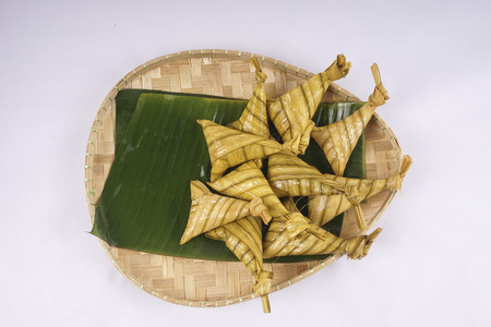 indonesian food: Ketupat or Dumpling Rice, a Malaysian or Indonesian food of day of celebration at end of fasting month, Ramadhan Stock Photo