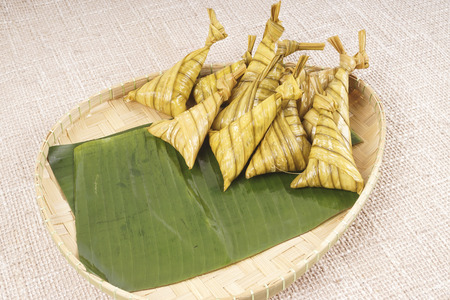 Famous traditional Malay foods during Ramadhan, Eid Fitr and Eid Adha i.e. of lemang (bamboo rice) ,ketupat (dumpling rice in coconut leaf) dan rendang beef. DOF and copy Stock Photo