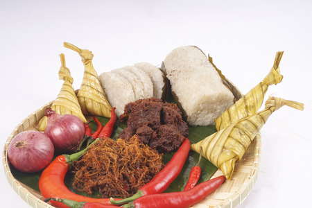 ie: Famous traditional Malay foods during Ramadhan, Eid Fitr and Eid Adha i.e. of lemang (bamboo rice) ,ketupat (dumpling rice in coconut leaf) dan rendang beef. DOF and copy space.