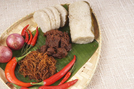 Famous traditional Malay foods during Ramadhan, Eid Fitr and Eid Adha i.e. of lemang (bamboo rice) ,ketupat (dumpling rice in coconut leaf) dan rendang beef. DOF and copy space.