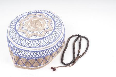 Tasbih and kopiah hat