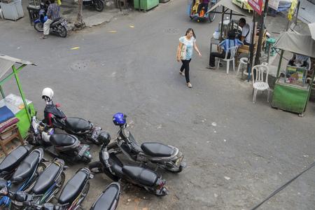 YOGYAKARTA: YOGYAKARTA, circa September 2014: Life within  Maliaboro Street. Yogyakarta, Indonesia Editorial