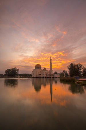 salam: Glorious sunrise over the mosque. Stock Photo