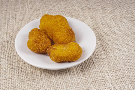 nugget: Fried nugget chicken on wooden table,