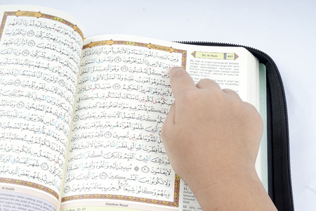 book of revelation: Boy ready a Quran. Stock Photo