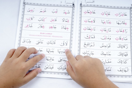 Boy reading Quran. Editorial