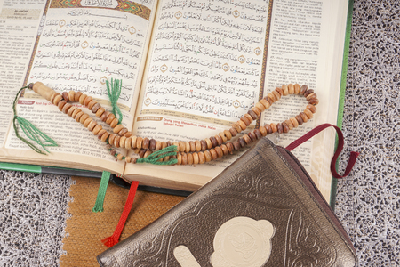 recite: The Holy Quran and tasbih. Copy space