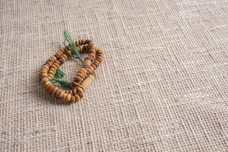 recite: The wooden Tasbih. DOF and copy space