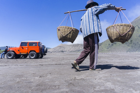 BROMO, INDONESIA - JULY 23, 2016: Unidentified Street seller at Bromo Mount. Editorial