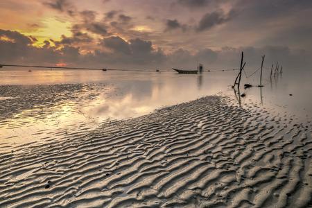 crepuscle: Amazing sunset with fishmen boat.