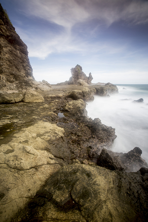 View of Watu Lampung Beach during cloudy day. Nature composition,grain and noise effect,soft focus and vibrant colours.