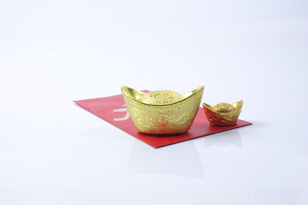 pow: Chinese new year festival decorations, ang pow or red packet and gold ingots. Chinese characters means luck,wealth and prosperity. Stock Photo