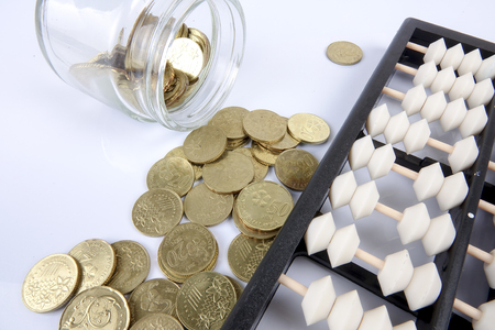 indebtedness: Abacus and coins. Business concept