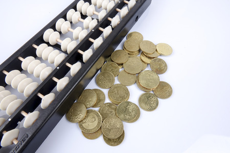 Abacus and coins. Business concept