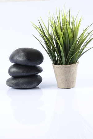 Zen stones isolated on white. Beauty and spa conceptual. Stock Photo