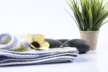 Zen stones,spa towel  and flowers. Beauty and spa conceptual.