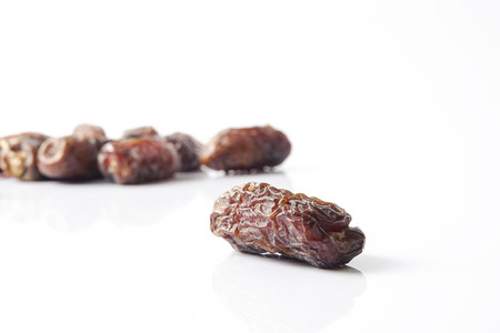 Date fruits on white background. Selective focus.