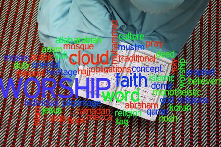 Girl reading al Quran with cloud words. Stock Photo