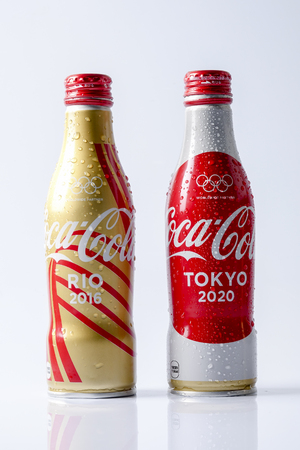 fizz: KUALA LUMPUR- MARCH 19, 2017: Coca-Cola world cups cans. Coca-cola is the worlds most selling carbonated soft drink Editorial